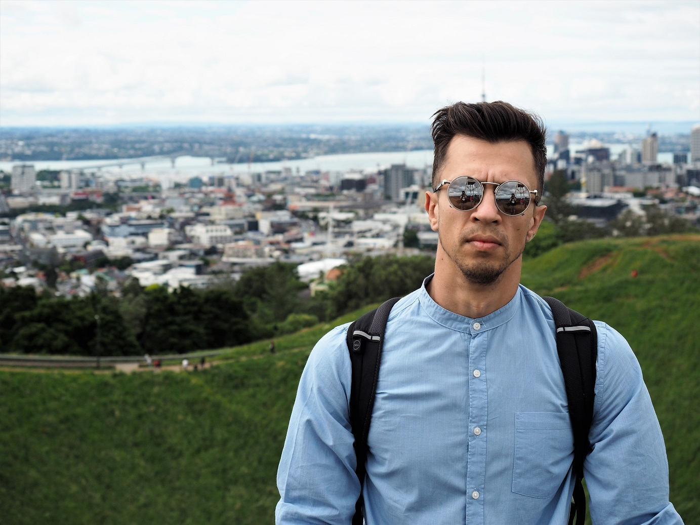 A guy and the Auckland panorama behind, New Zealand