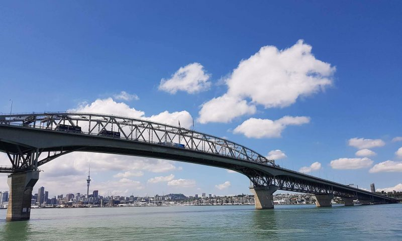 Auckland Harbor bridge and Sky tower in horizon, New Zealand