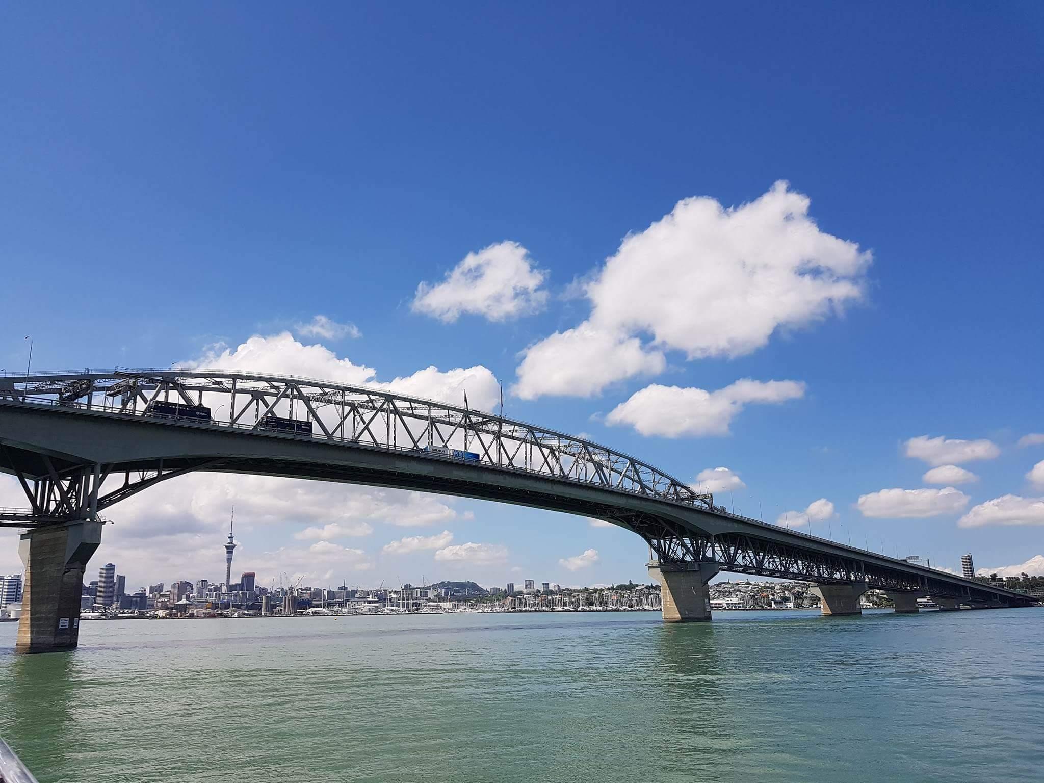 Auckland Harbor bridge and Sky tower in horizon, New Zealand