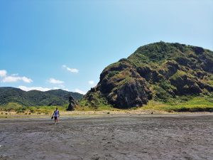 Running on black sand in Whatipu beach