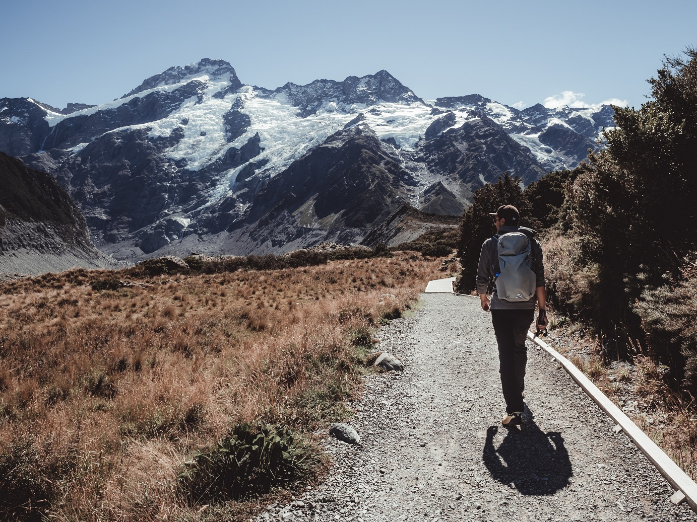 A guy hiking in Hooker Valley, Aoraki/Mt. Cook National Park, New Zealand