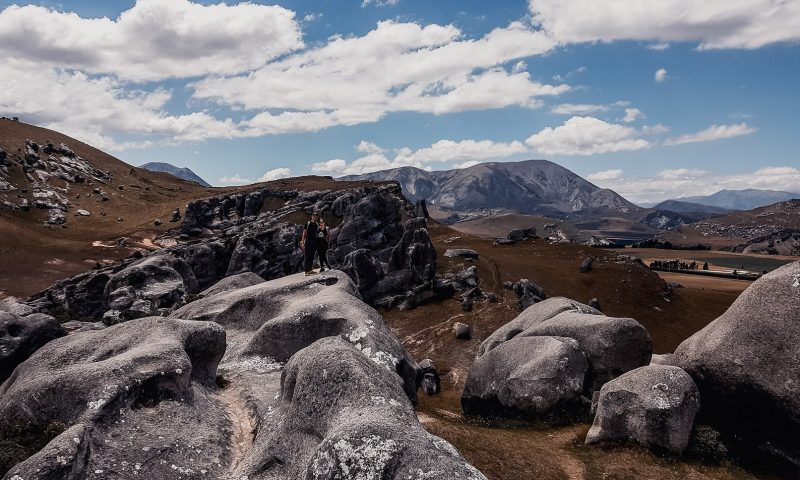 Couple on the boulders at Kura tawhiti, South Island, New Zealand