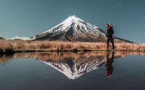 Travel couple at Mount Taranaki, New Zealand